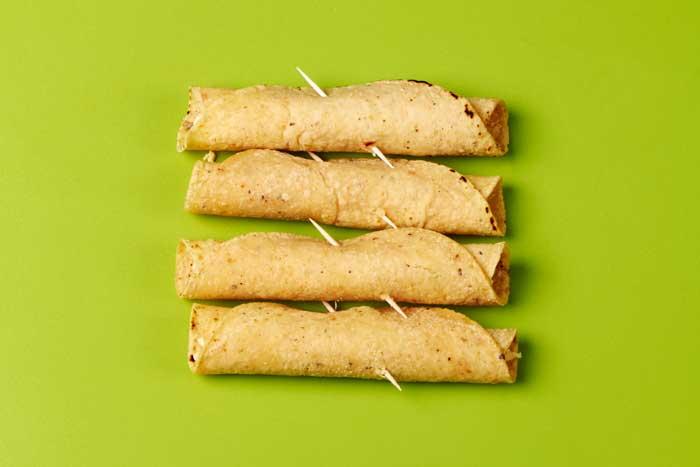 Four Taquitos Ready to Fry