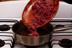 Adding the Meat to the Pan