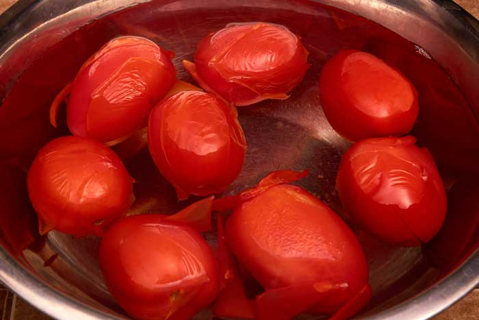 Tomatoes Cooling in Water