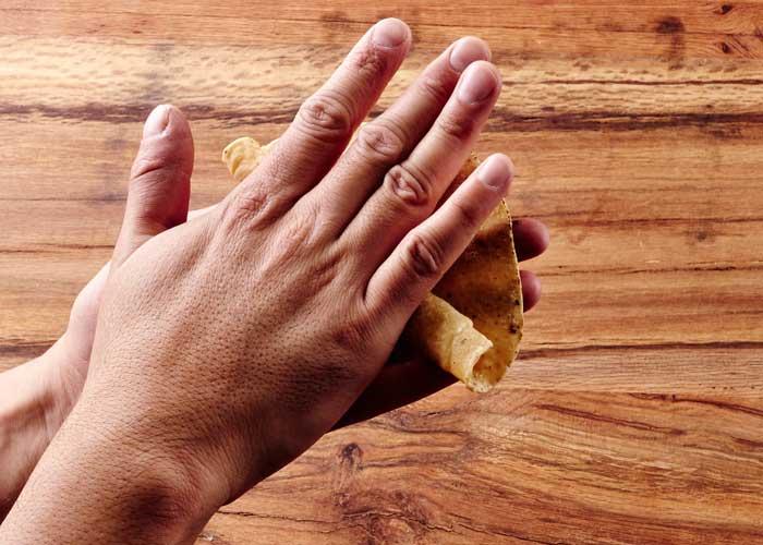 Hand Rolling a Corn Tortilla