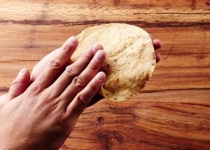 Rolling a Corn Tortilla