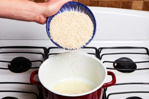 Adding Rice to Oil in Pan