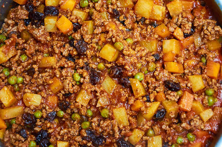 Cook the picadillo over medium-low heat for 20 minutes until fully cooked.