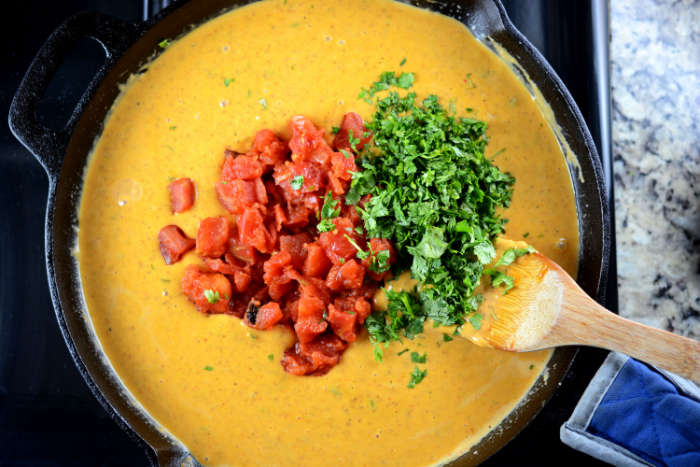 Adding Tomatoes and Cilantro to Melted Cheese