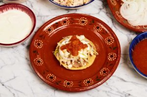 Chicken Tostada Topped With Salsa Roja