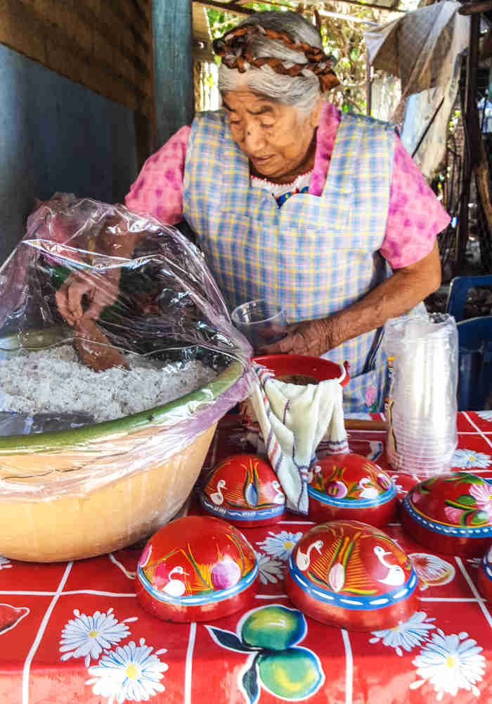 Local woman serving Tejate - the most popular local drink in Oaxaca