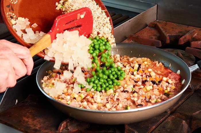 Adding Biznaga Raisins Peas