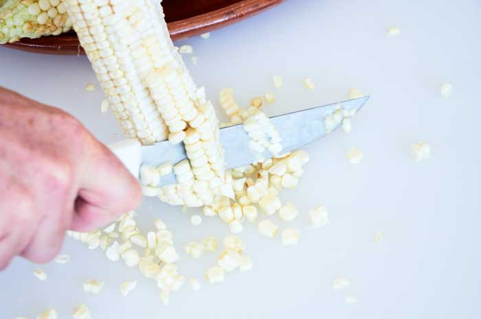 Removing Kernals of Corn from the Ear