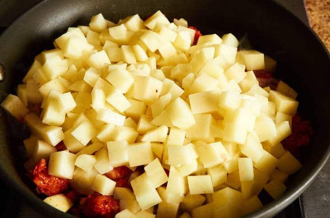 Adding Potatoes to Browned Chorizo