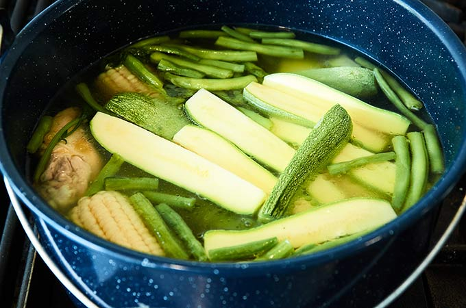 Chicken and Vegetables Cooking in Enamel Pot