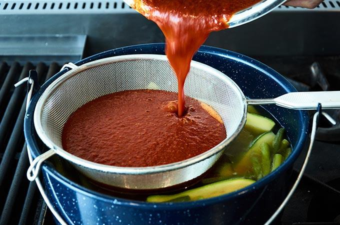Straining Guajillo Tomato Base