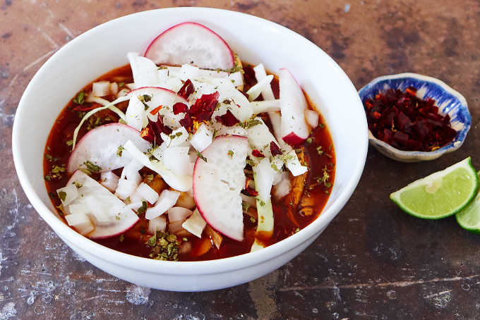 Bowl of Authentic Red Pork Pozole With Garnishes