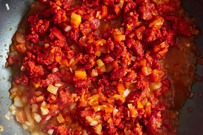 Cooking Chorizo with Tomato and Onion