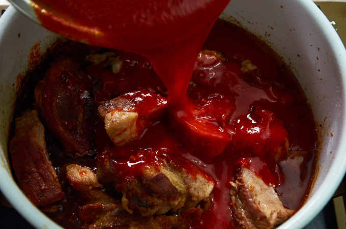 Adding Salsa Roja to Pork Ribs