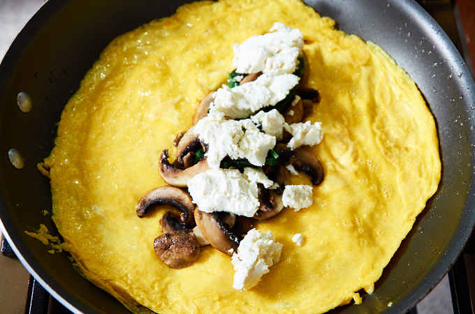Making Spinach Goat Cheese Omelette in Pan