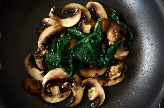 Sauteed Mushrooms and Spinach in Pan