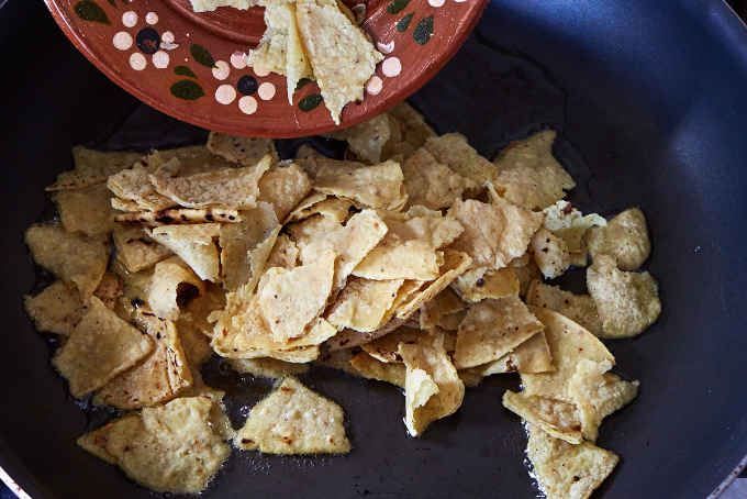 Adding Tortilla Strips to Hot Oil in Pan
