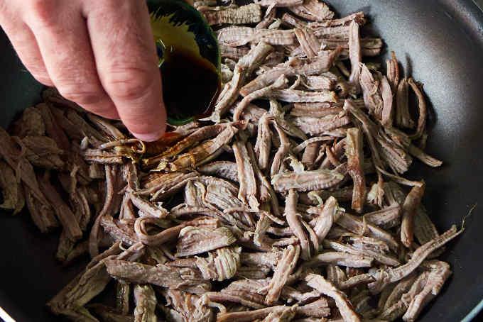 Seasoning Shredded Beef in Pan