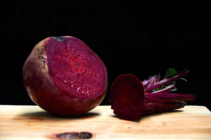 Beet on Cutting Board with Top Cut Off