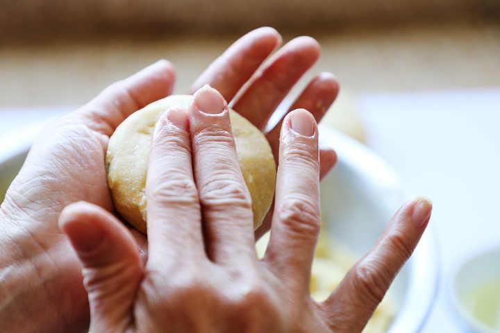Hand forming potato croquettes.