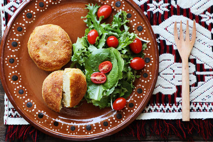 Mashed potato croquettes with green salad.