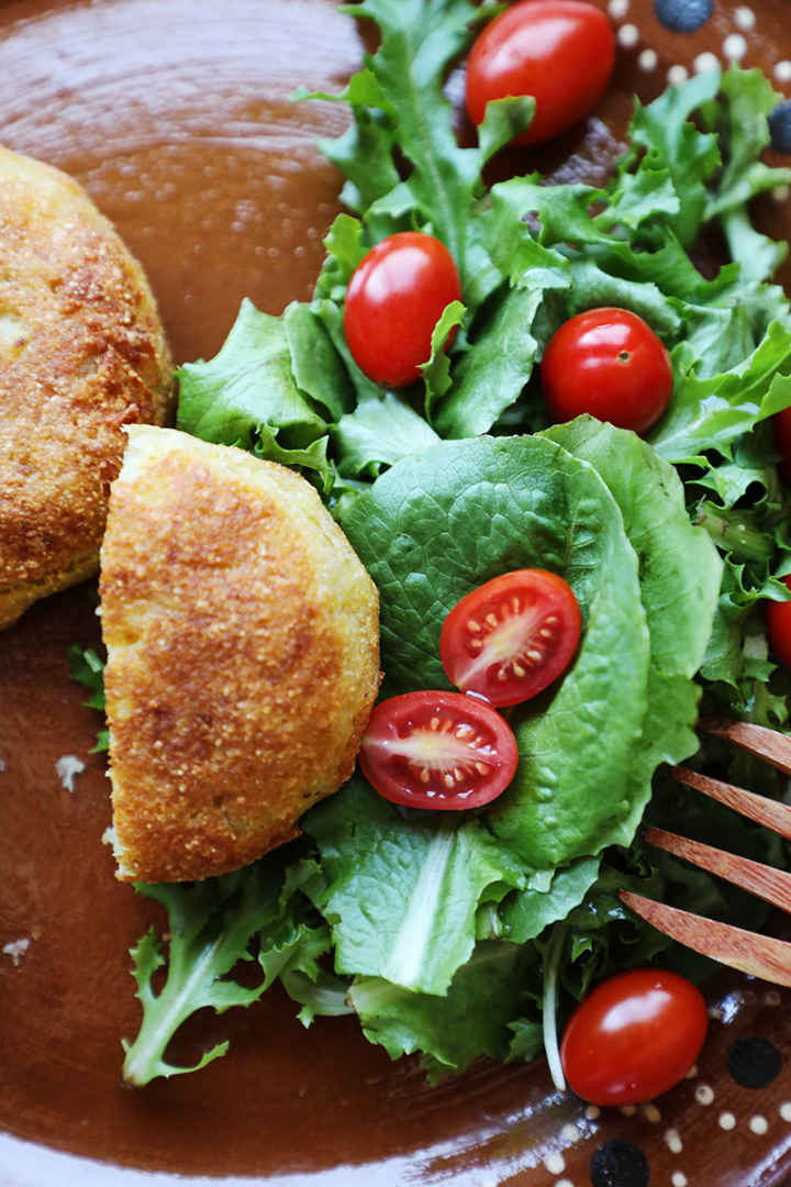 Mexican potato croquettes with a green salad.