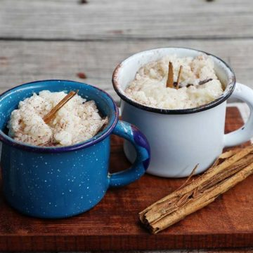 Cups of Mexican arroz con leche on table.
