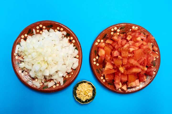 Plates of Chopped Onion Tomato Garlic