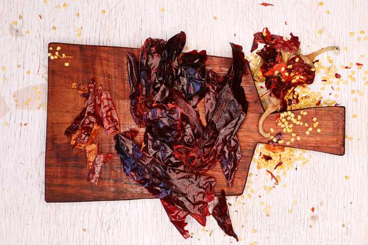 Seeded guajillo chiles on cutting board.