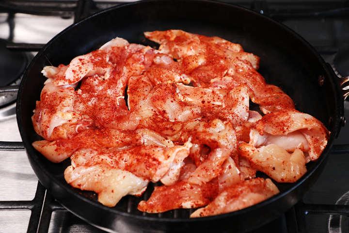 Cooking Seasoned Chicken in Frying Pan