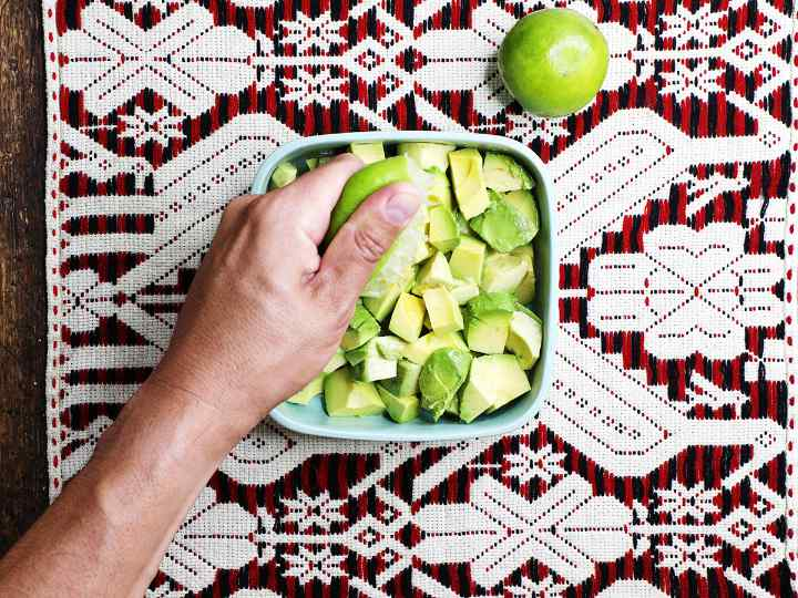 Adding Lime Juice to Cubed Avocado