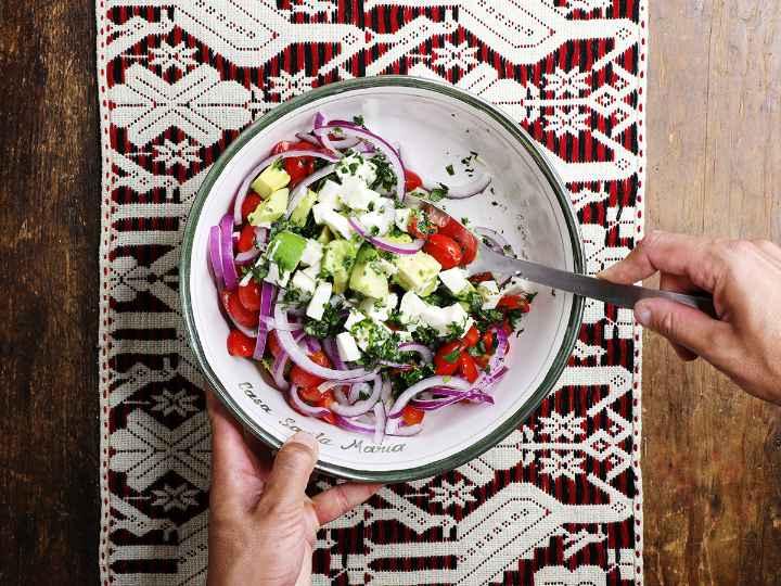 Mixing Avocado Salad