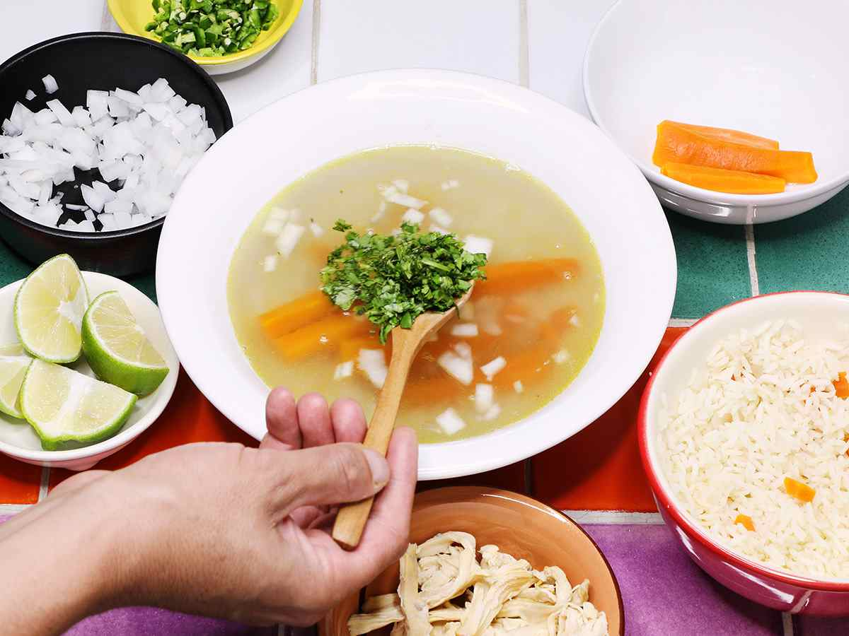 Garnishing Mexican Chicken Soup with Cilantro