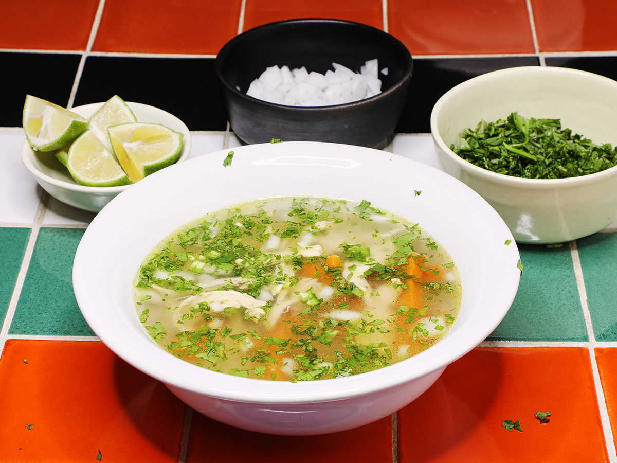 Bowl of Mexican Chicken Soup with Garnish