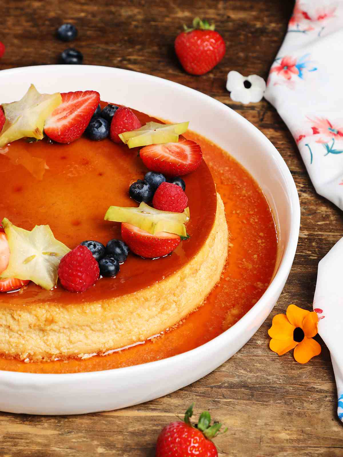 Mexican Flan topped with berries and star fruit