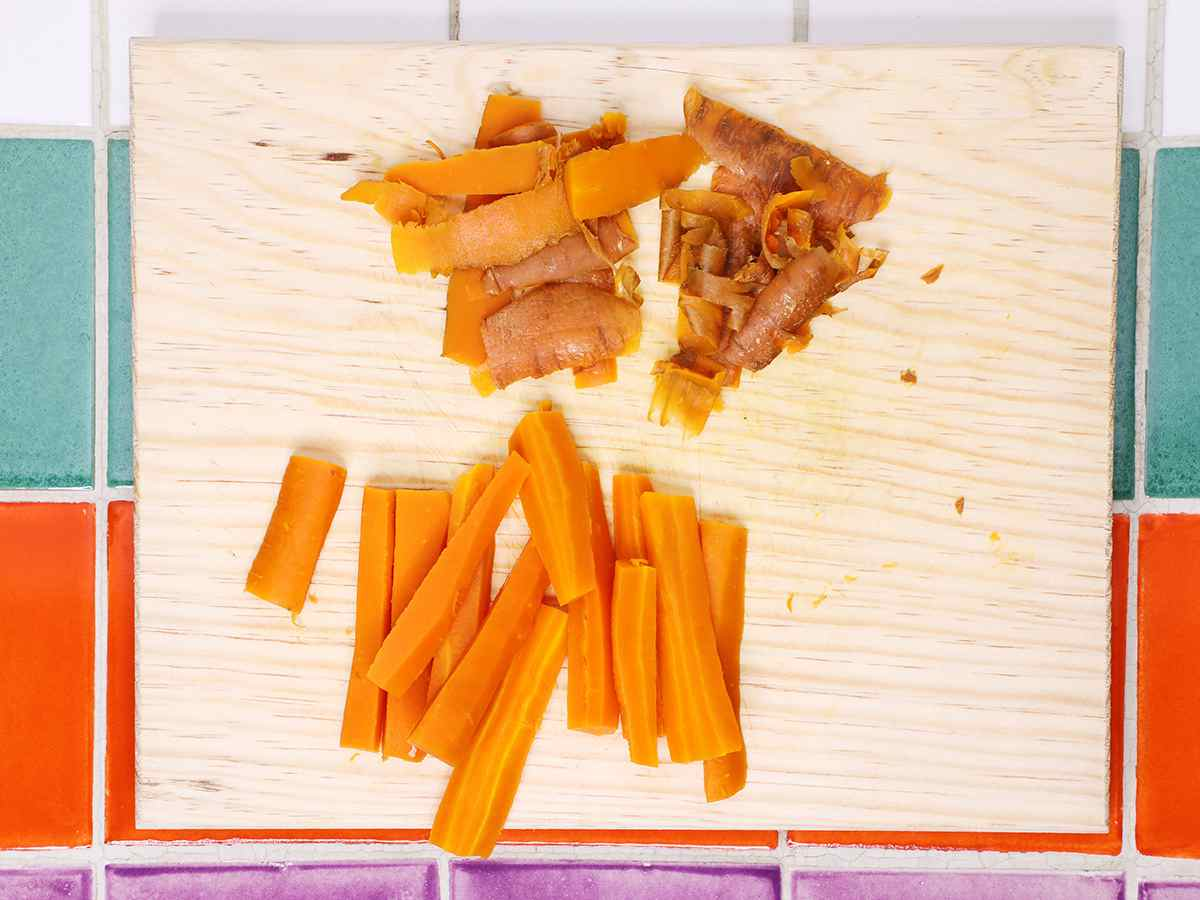 Peeled Cooked Carrots on Cutting Board