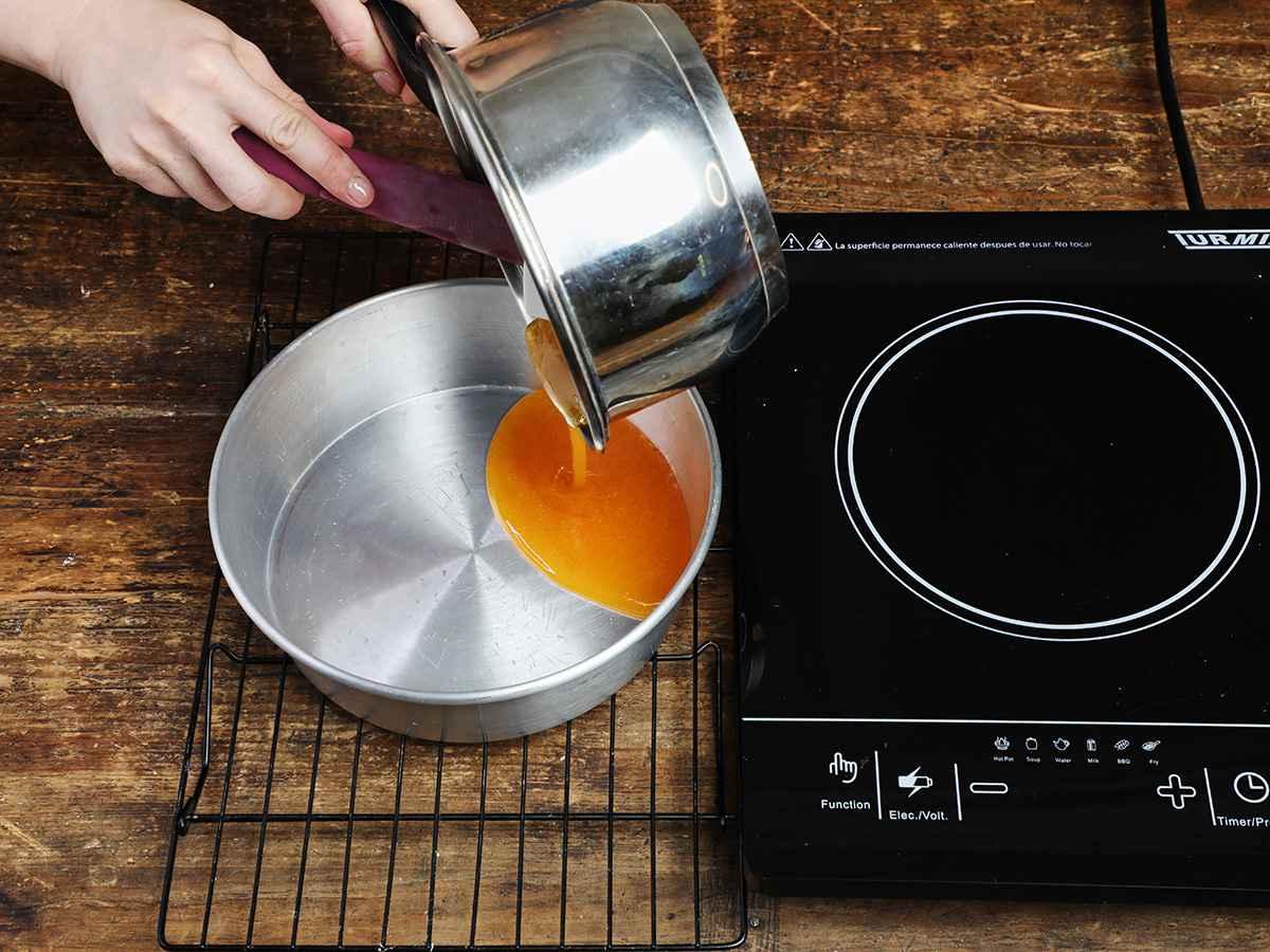 Pouring Caramel Sauce into Flan Pan