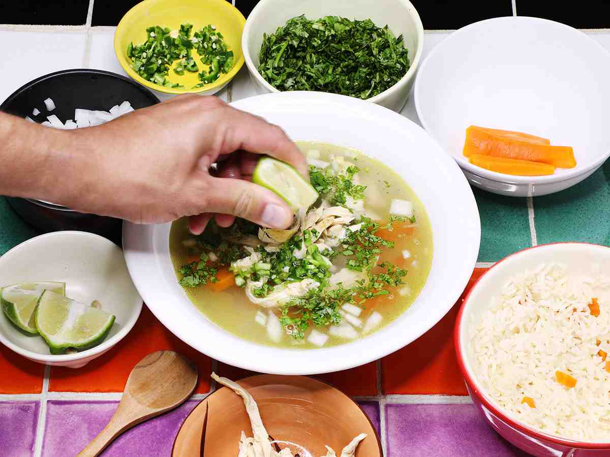 Squeezing Lemon into Mexican Chicken Soup