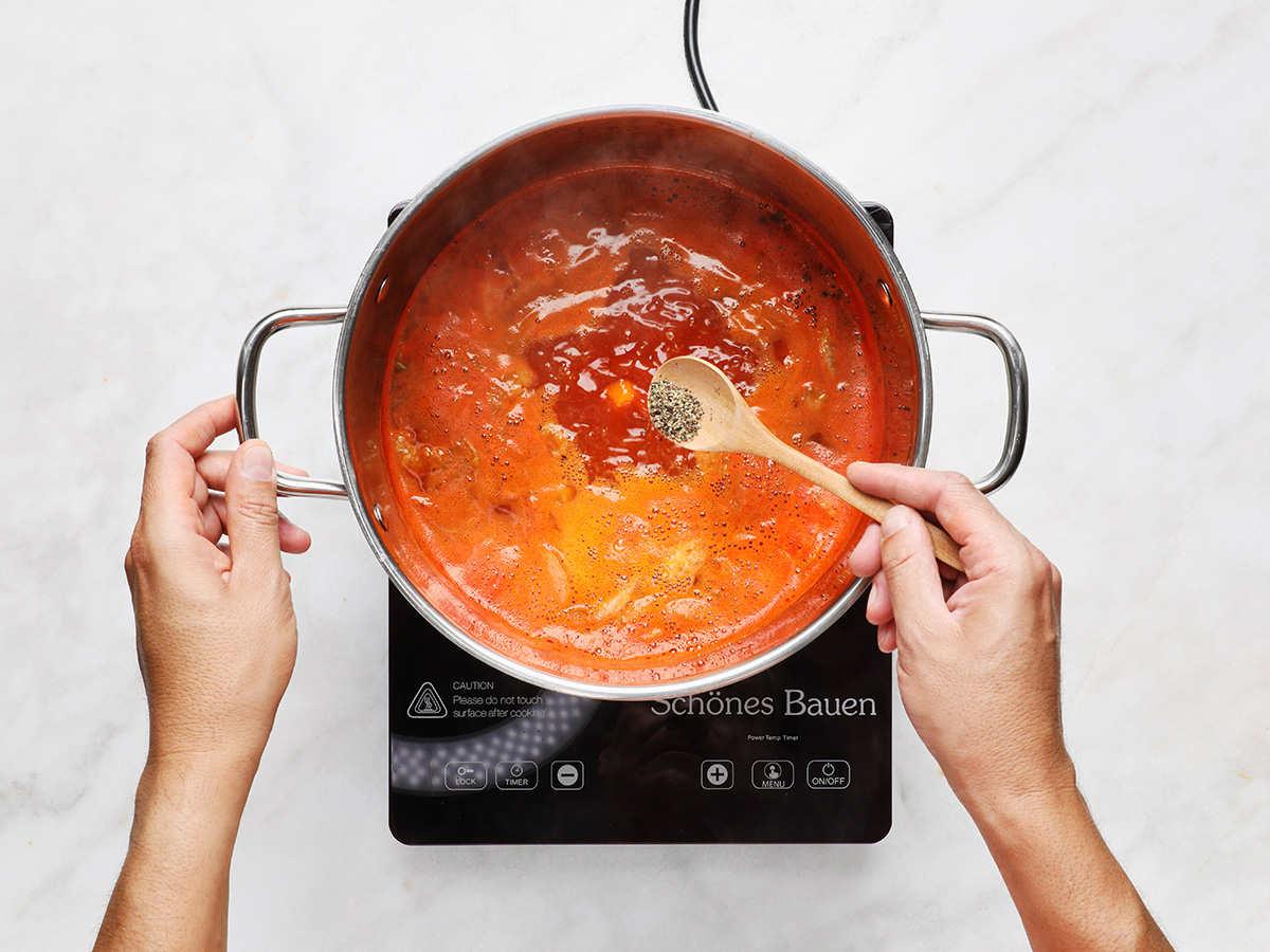 Adding Pepper to Caldo de Camarón
