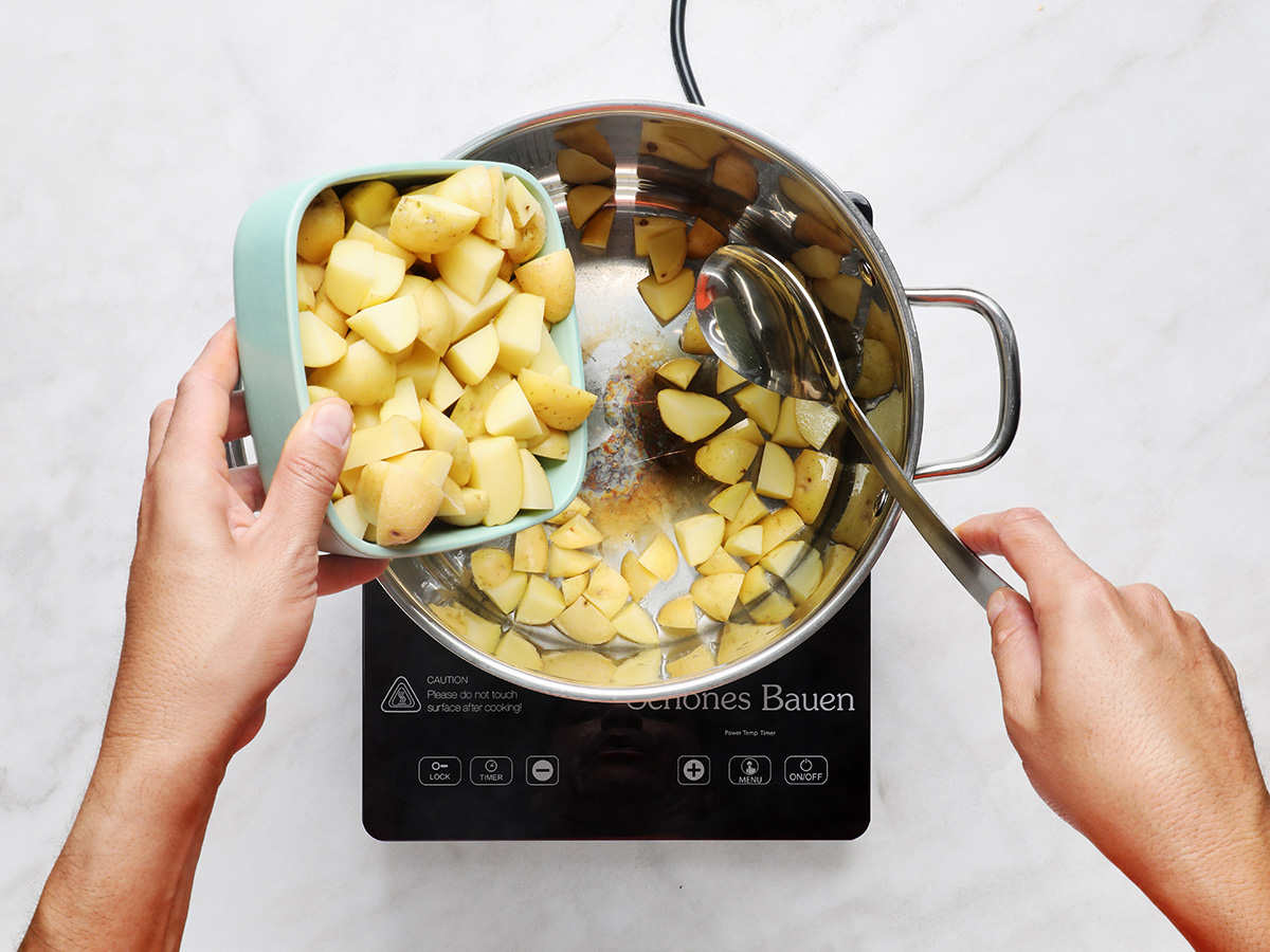 Adding Cambray Potatoes to Soup Pot