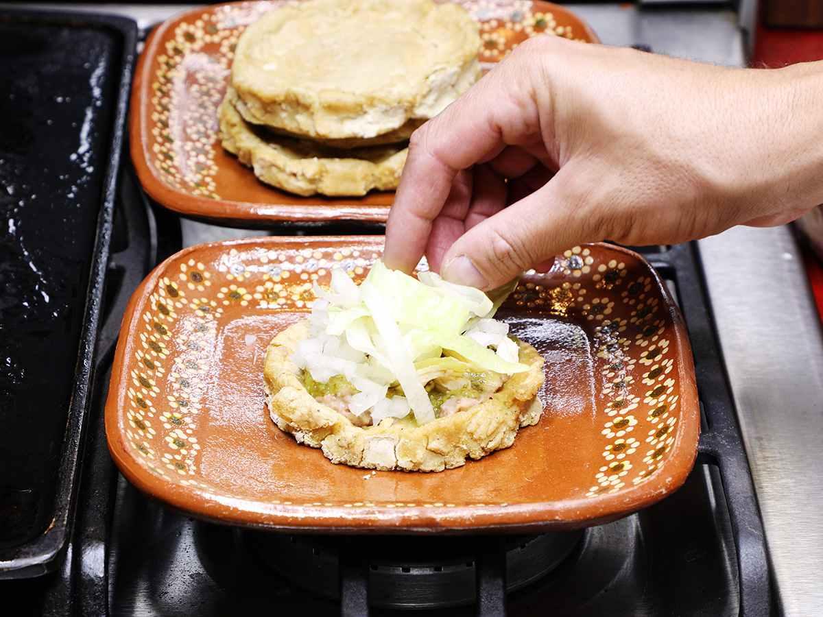 Shredded Lettuce on Sopes