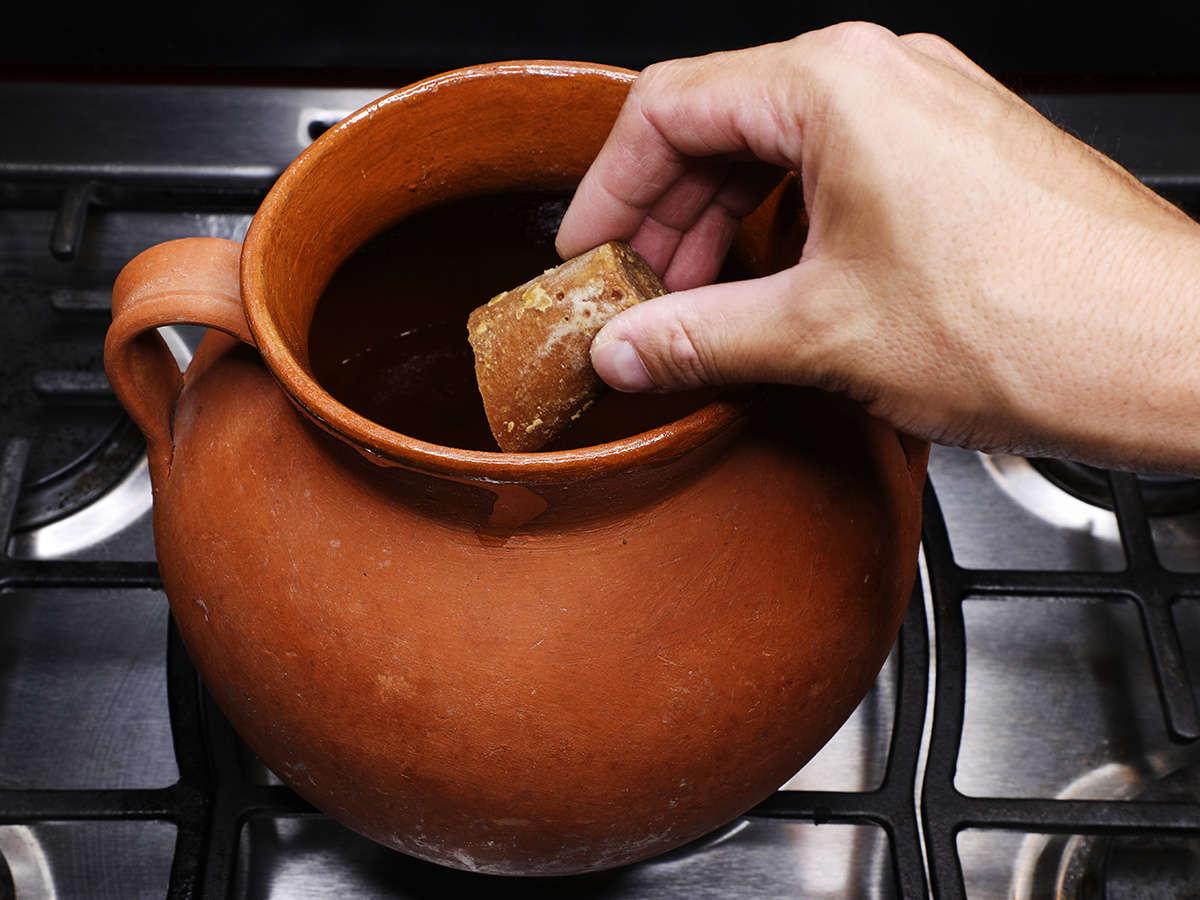 Adding Piloncillo to Pot