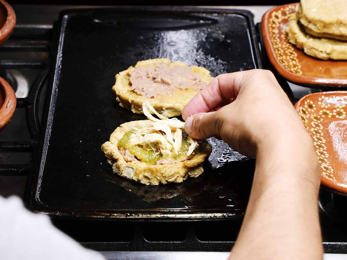 Adding Shredded Chicken to Sope