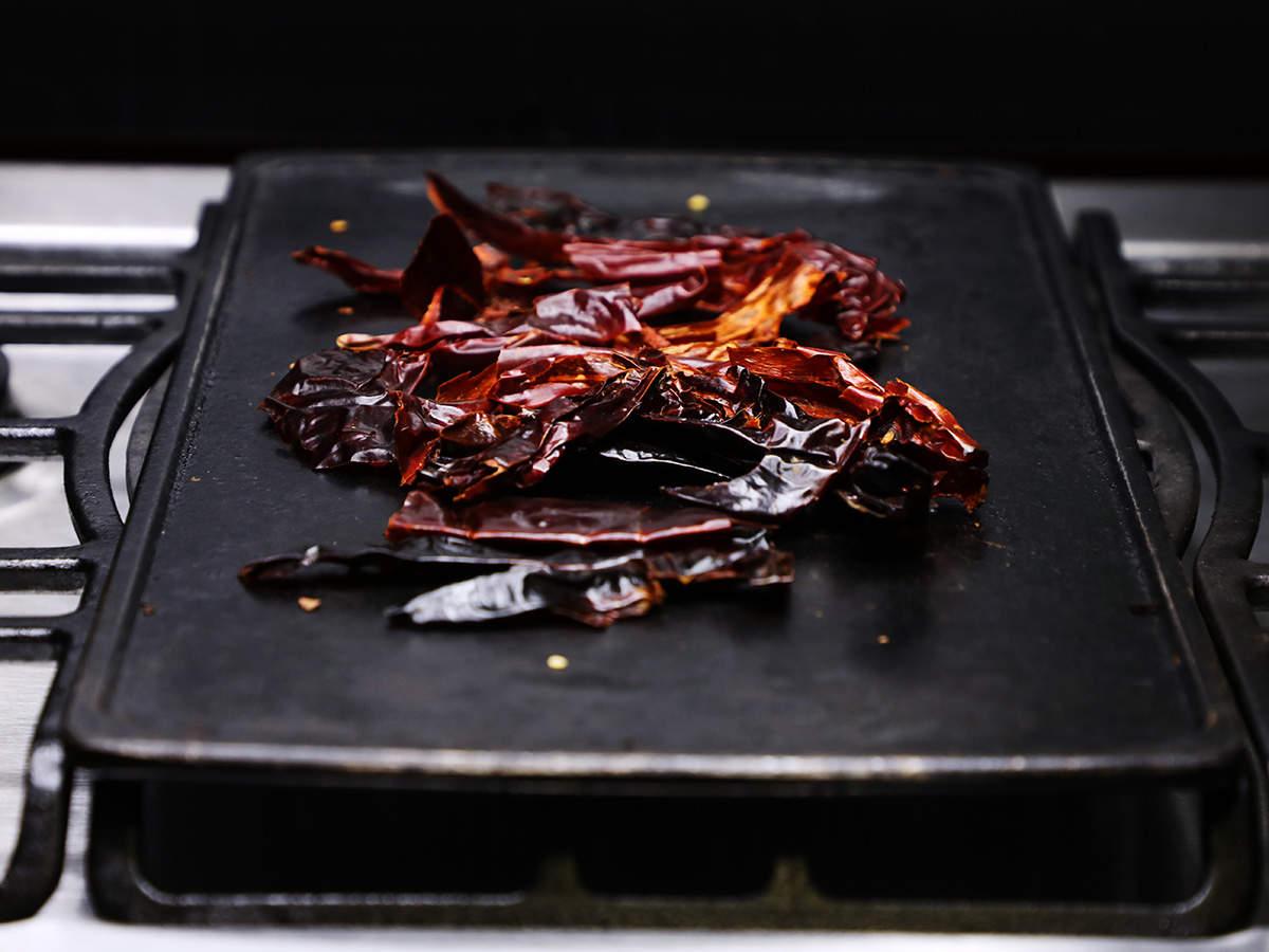 Guajillo Chilis Toasting on Griddle