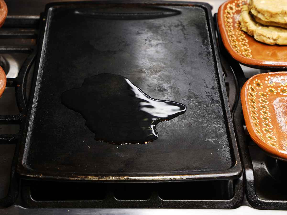 Pouring Oil on Griddle