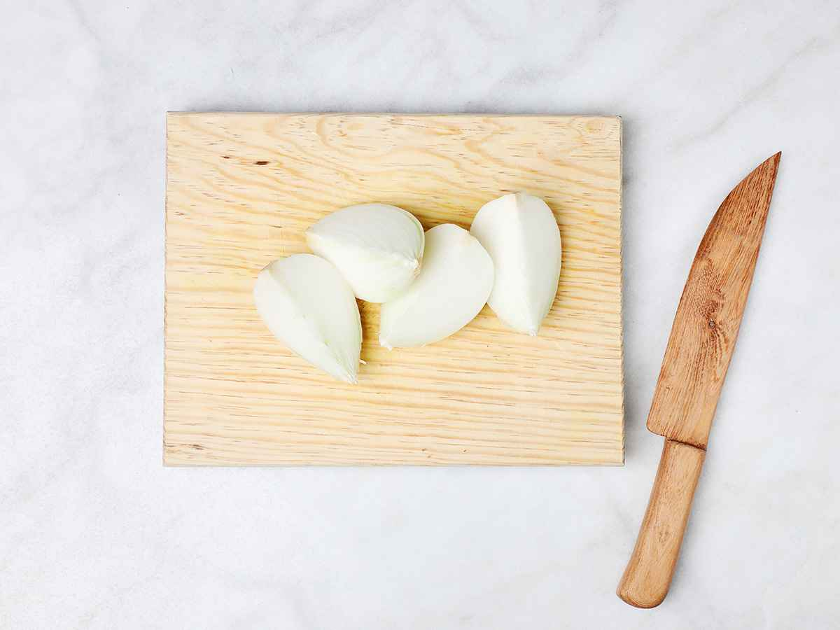 Quartered Onion on Cutting Board