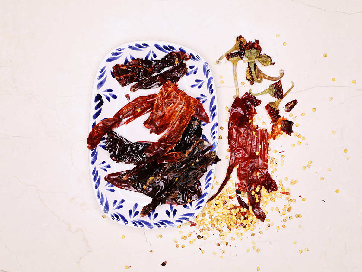Removing Seeds from Guajillo Chilis