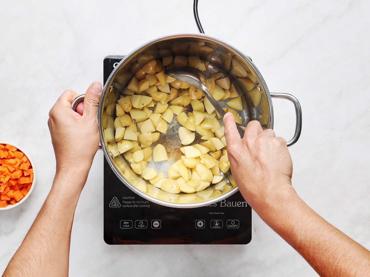 Stirring Cambray Potatoes on Stovetop