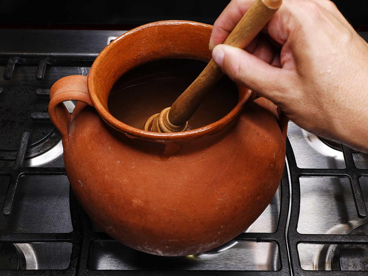 Stirring Champurrado with Molinillo