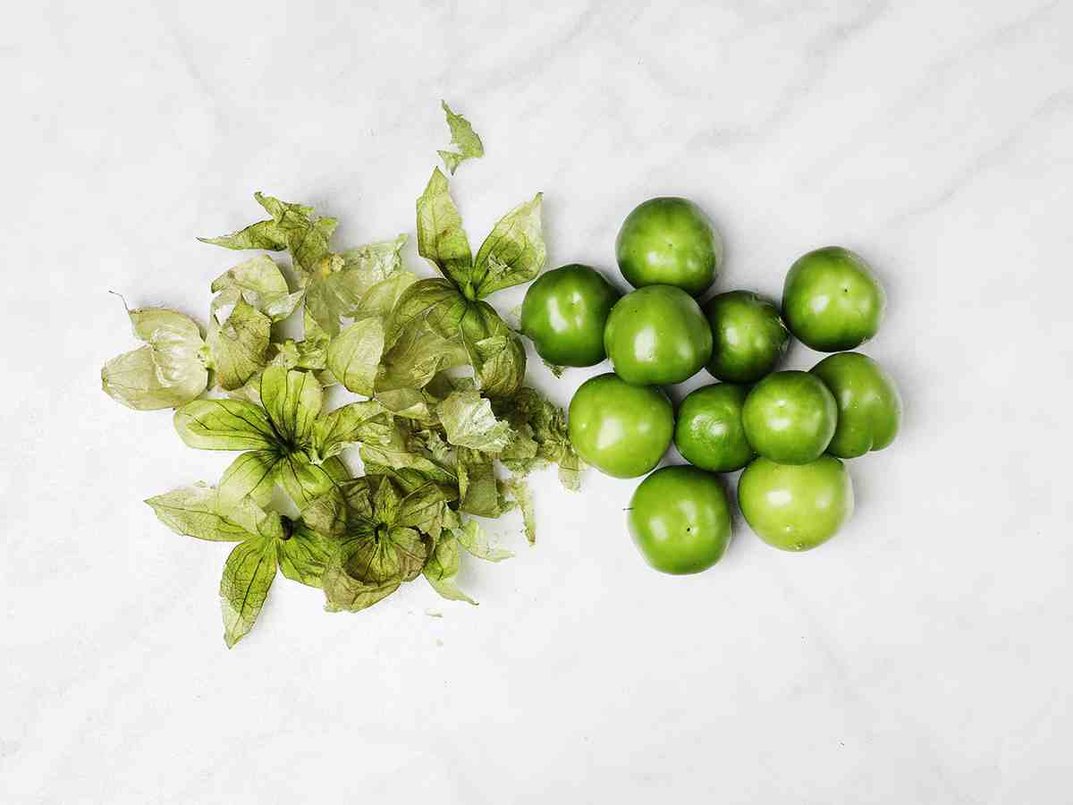 Tomatillos with Husks Removed on Table